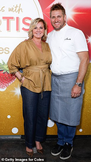 In uniform: Curtis wore his chef's jacket, blue jeans, sneakers and an apron