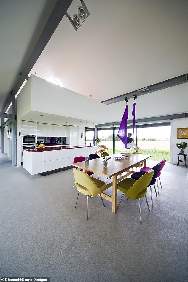 Presenter Kevin is impressed by how 'sleek and pristine' the finished project is.' Pictured, the open plan kitchen and dining area