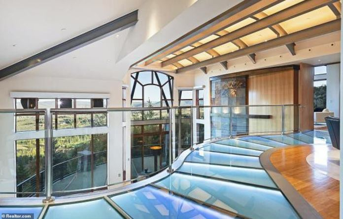 The incredible mansion has modern glass floors and breathtaking views of the surrounding scenery of the pad nestled in the mountains