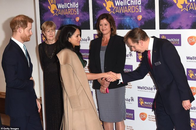 One official bowed his head as they shook hands with Meghan Markle and Prince Harry looked on