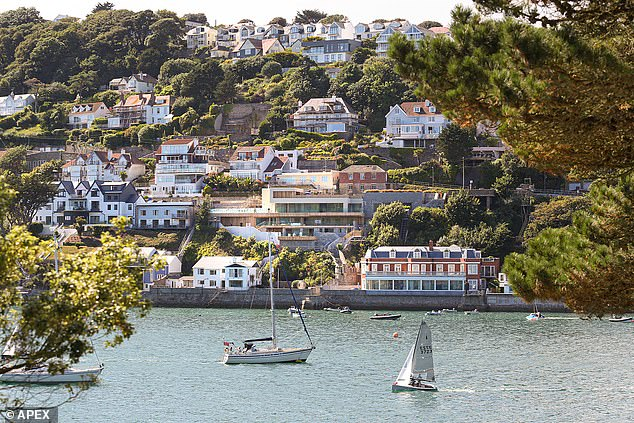 The Woodfords also have a second luxury home on the Devon coast in the town of Salcombe (pictured centre)