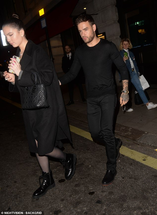 Off they go: TheWhat Makes You Beautiful singer looked typically dapper in an all-black ensemble as he departed theMayfair eatery