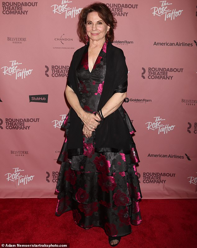 Grande dame:Carolyn Mignini, who is playing Assunta, wrapped a black shawl over her black and scarlet floral gown as she posed up on the red carpet