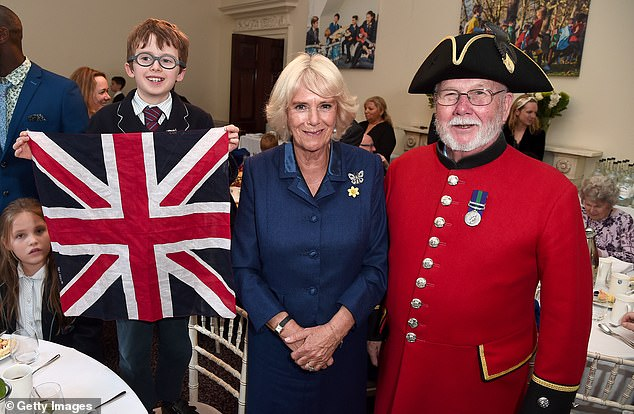 Camilla appeared particularly charmed by one pairing, with one little boy carrying a Union flag at the occasion