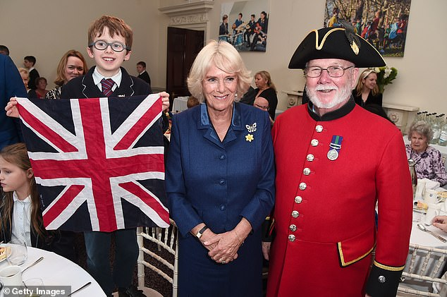 The Duchess of Cornwall went on to pose alongside care home residents and school pupils who attended the tea party having both learnt the same poem, before they went on to recite them off-by-heart
