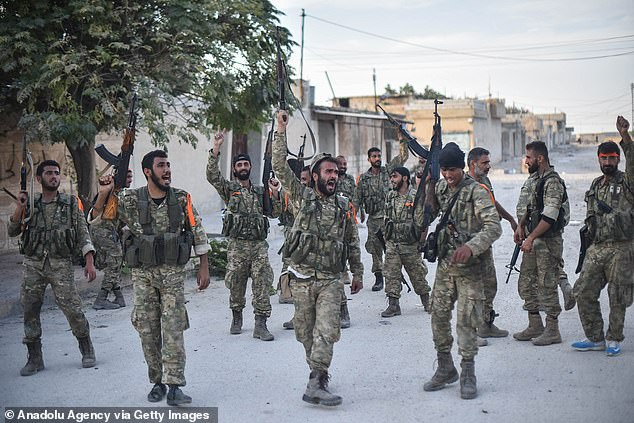 Brandishing their AK-47 and M16 rifles in the air, the self-styled Syrian National Army (SNA) – a mishmash of troops from various Syrian opposition groups – paraded victoriously through the streets of Ras al-Ayn