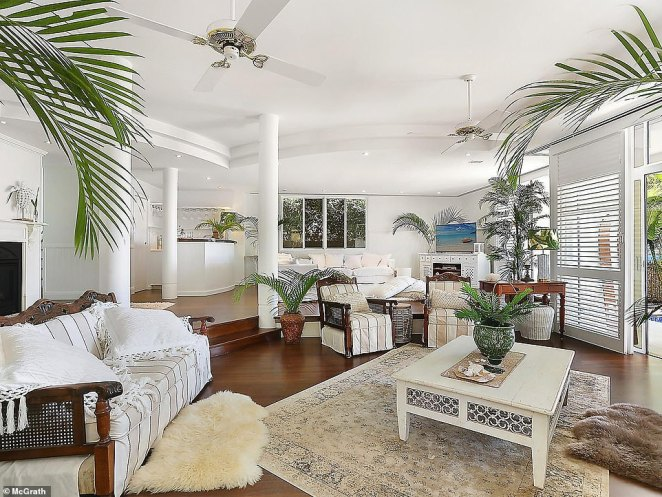 Brisbane-based Kerrie and Paul were both nearly 40 and living the ultimate high-flying city life when they decided to leave the city of Brisbane for 'open spaces, the lush tropics and an ability to sail away on the weekend' (living area pictured after)