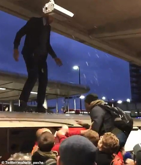 This morning commuters at Canning Town station reacted furiously to an XR protestor climbing on top of their train