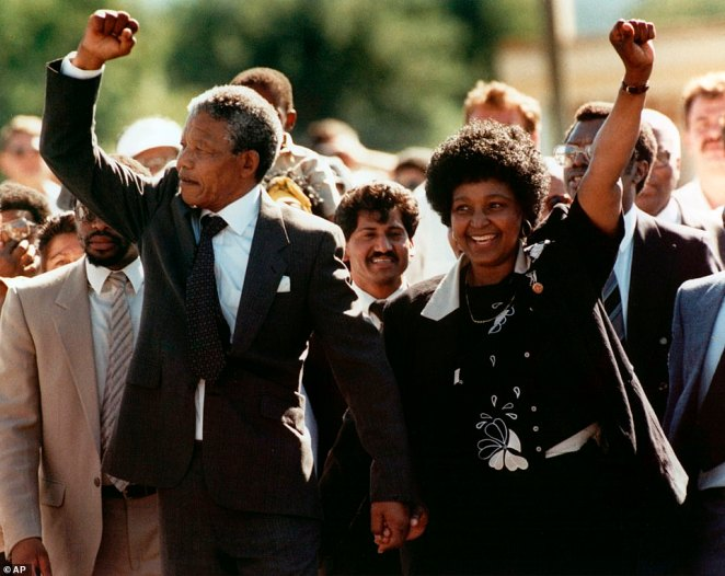 Nelson Mandela and wife Winnie, walk hand in hand, raising their clenched fists upon his release from Victor prison, Cape Town. He was release on February 11, 1990 after 27 years in detention. Mandela was previously held at the notorious Robben Island before the fall of apartheid in South Africa. He went on o be the country's first black head of state in 1994. On December 5, 2013, the country's state broadcaster announced the 95-year-old former president had died at his home in Johannesburg. This image received 23 per cent of the vote in the HISTORY poll