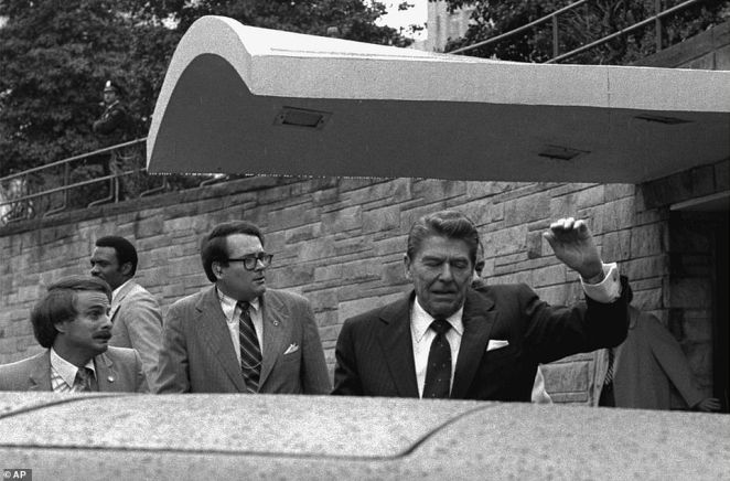 US President Ronald Reagan winces and raises his left arm as he was shot by an assailant as he left the Washington Hilton Hotel on March 30, 1981, after making a speech to a labour group. The president was shot in the upper left side but survived the assassination attempt.Reagan was seriously wounded by the .22 Long Rifle bullet that ricocheted off the side of the presidential limousine and hit him in the left underarm, breaking a rib, puncturing a lung and causing serious internal bleeding. Although 'close to death' when he arrived at George Washington University Hospital, Reagan was stabilised in the emergency room. This image received eight per cent of the vote