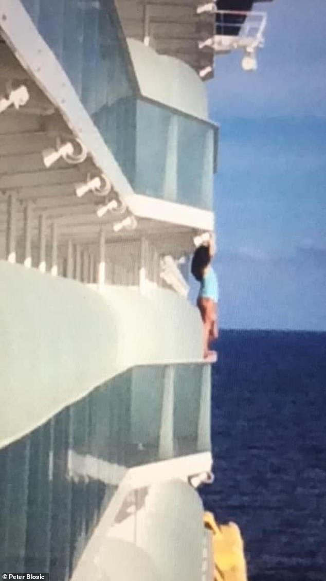 A passenger on a cruise ship has been slammed for climbing over a balcony railing to get a better shot of herself in a swimsuit.
