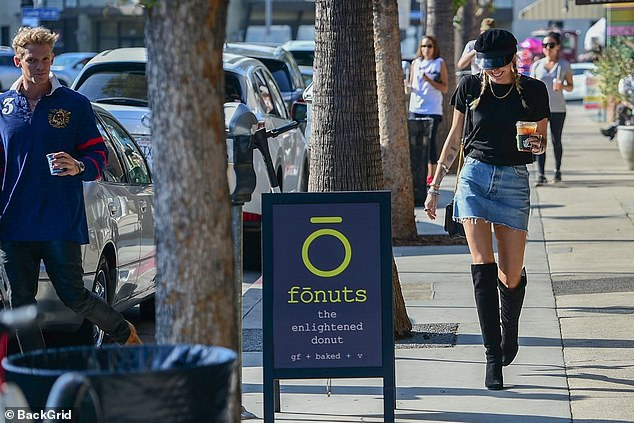 Sunny day:Miley Cyrus, 26, and her boyfriend Cody Simpson, 22, were snapped stopping off for beverages at at Alfred Coffee in Studio City, California,