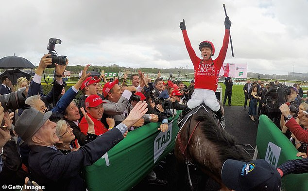 Jockey Kerrin McEvoy celebrates in the winner's stall after taking out The Everest in 2018, making it back-to-back wins in the world's richest race on turf. Largely as a result of those wins, Redzel has the extraordinary career prizemoney haul of $15.7 million.