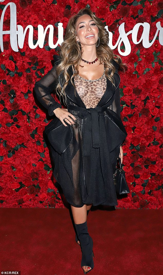 Happy days: Farrah was showing off her surgically-enhanced figure to perfection during her move along the red carpet in the scanty ensemble