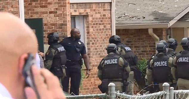 A massive police presence descended on an apartment associated with the two people of interest on Wednesday morning