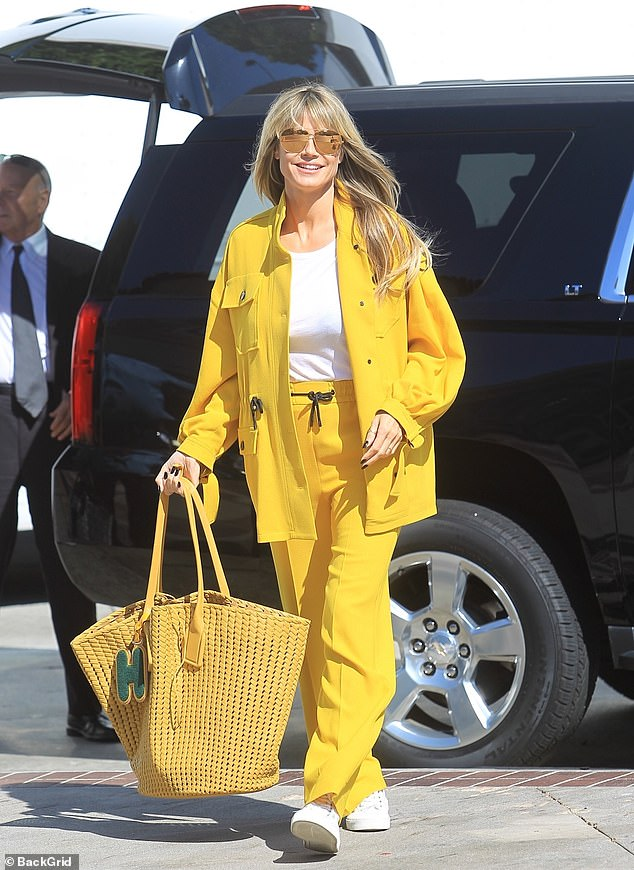 Hard at work! America's Got Talent: The Champions judge Heidi Klum arrived on the Pasadena set Friday wearing a yellow jacket and elastic-waist pants