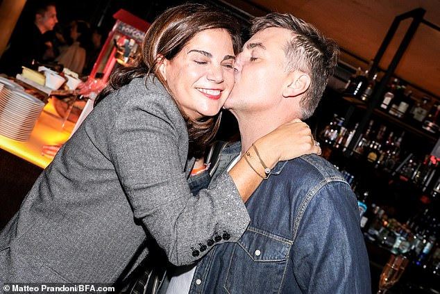 She is very loved! Pavlos got a kiss on the cheek from New Yorker Euan Rellie