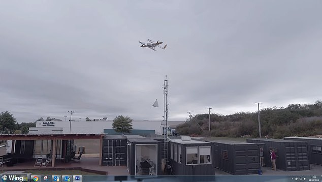 A Wing delivery drone lowers a cord onto which the package is hooked and then lifted back up to the drone