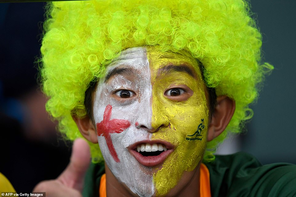 Japan will also hope to reach the semi-final after a string of unexpected victories which has fired up the host nation (a supporter sports both England and Australia colours)