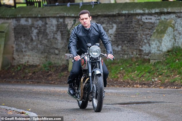 Wild:Tom Brittney donned his leathers and zoomed around on a motorbike as he filmed scenes for Grantchester in Cambridgeshire on Thursday