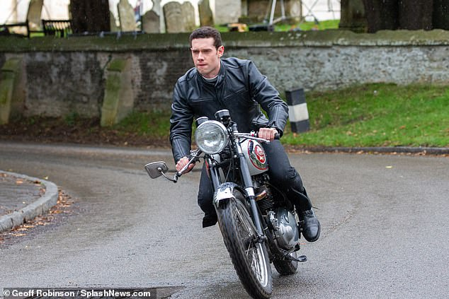 Easy rider:The actor, who has taken over as the lead from James Norton, looked in his element as he zipped through the quiet streets of Cambridgeshire during filming