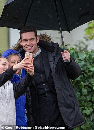 Say cheese: Tom stopped for a fun selfie with fans