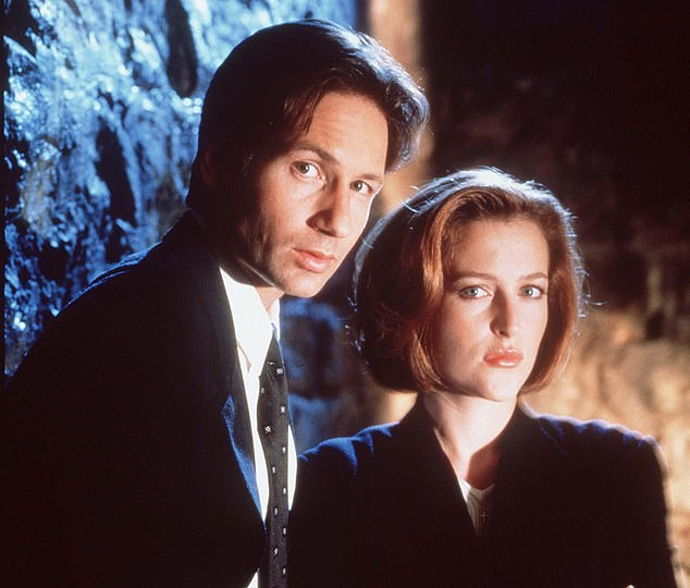 Anderson (right) first sprang to fame in the 1990s supernatural drama The X-Files, with its tag line 'the truth is out there'. She played sceptical FBI agent Dana Scully, alongside David Duchovny (left) as Fox Mulder