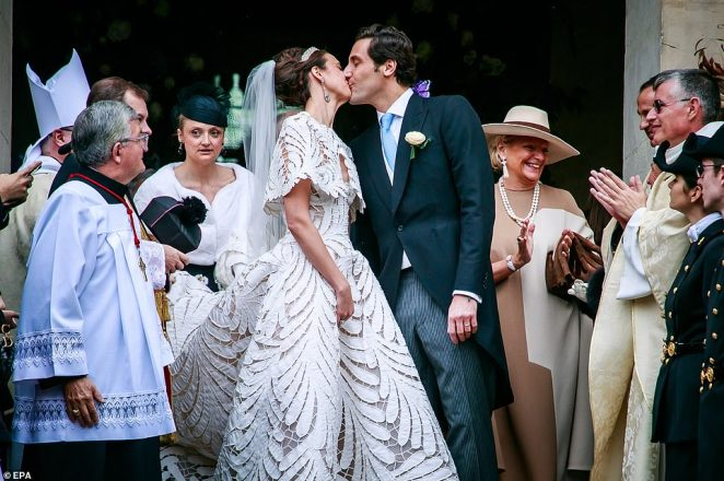 The great-great-great niece of the French Emperor's wife, Countess Olympia von und zu Arco-Zinnerberg, 31, married Jean-Christophe Napoleon Bonaparte, 32, French Emperor Bonaparte's heir. The couple pose outside the cathedral after their wedding