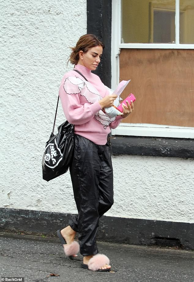 Feeling lucky: The former glamour model looked optimistic as she emerged from the newsagents smiling