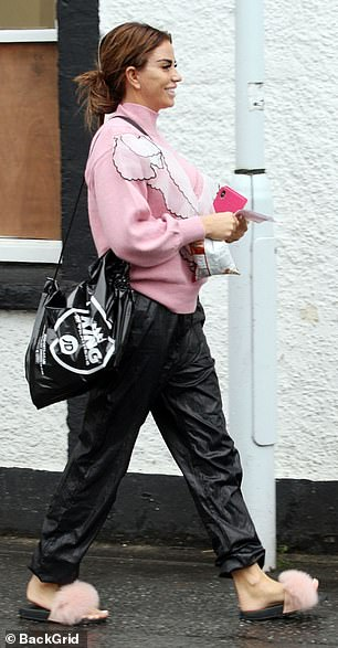 Pretty in pink: She opted for comfort on her feet with fluffy pink sliders