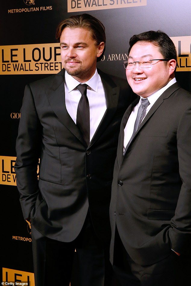 Harrow-educated financier Jho Low, 38, (right) who was accused of stealing £3 billion from the Malaysian government helped finance 'The Wolf of Wall Street' and was seen on occasions in the company of the film's star Leonardo DiCaprio,44 (left)
