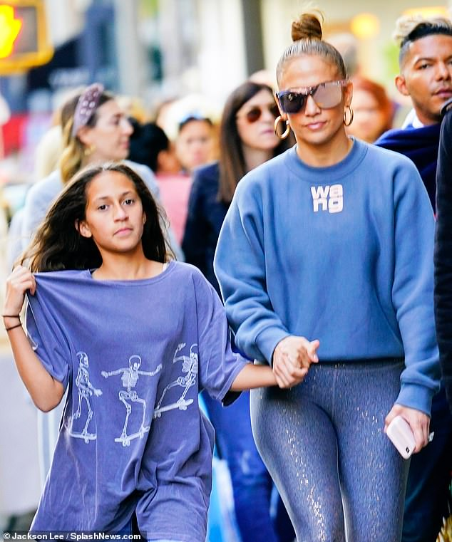 Emme: The daughter Jennifer shares with ex-husband Marc Anthony wore ripped blue jeans with an oversize blue T-shirt