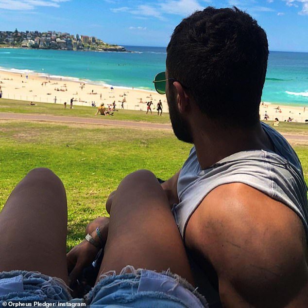 Relaxing date: In another post, the pair sat on Bondi's grassy knoll as they looked out towards the famous beach