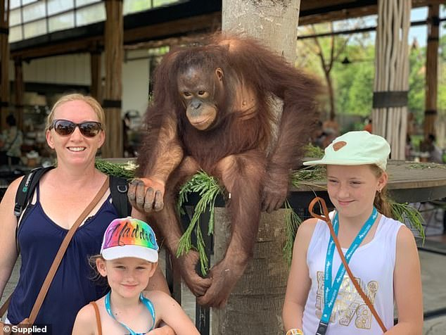 The orangutan was far more behaved when his family posed for a picture