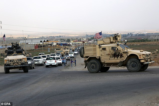 A convoy of US troops arrives back from Duhok, a Kurdish town in northeastern Syria on Monday