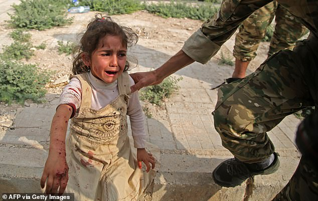 A Syrian girl reacts to her wounds on Sunday in the Syrian border town of Tal Abyad which was seized by Turkish-backed forces last week.Save the Children said their team in Syria recently spoke to a British mother with two young children - a baby and an under-five - in one of the camps. She told the charity she knew of at least 15 other British children in the same camp