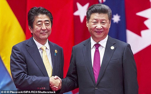 In 2014, a photographed handshake between President Xi and Japanese Prime Minister Shinzo Abe (not the one above) also sparked internet memes. Above, Abe and Xi shake hands before a group photo session for the G20 Summit in Hangzhou, China, in September, 2017