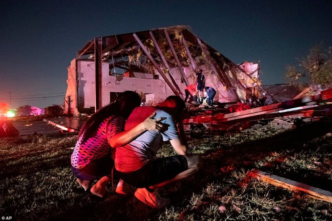 Henry Ramirez, a member of Primera Iglesia Dallas, is consoled by his mother Maribel Morales as they survey severe damage to the Primeria Iglesia Dallas church