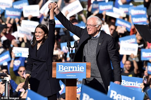Alexandria Ocasio-Cortez endorses 2020 democratic presidential candidate Bernie Sanders at a Bernie Sanders campaign rally in Queensbridge Park on October 19, 2019 in Queens, New York City. Sanders was at 9 per cent in the poll following his heart attack