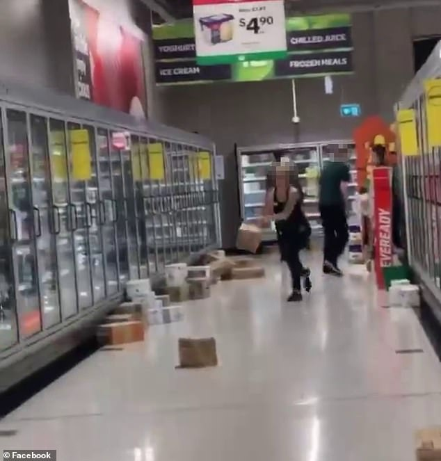 Woolworths staff have been captured throwing boxes of food (pictured) down supermarket aisles in a Brisbane store