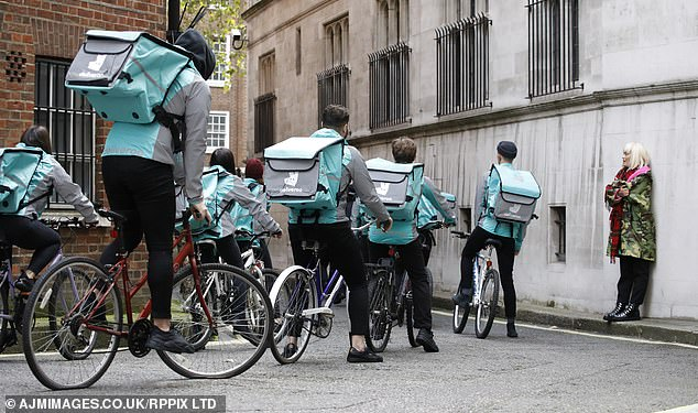 What's on the menu: A group of extras were also on hand to portray Deliveroo employees