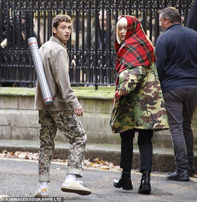 Stepping out in style: Model Rafferty sported camouflage print trousers with a taupe jacket
