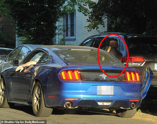 The source added: 'The suspicion is that when their divorces are finalized they will quietly decide to make it official. Maybe then the lies, the hypocrisy, all the sneaking around will finally come to an end.' Pictured: Mynett with his arm dangling a cigarette out of his window while Omar hops into his waiting car on September 26
