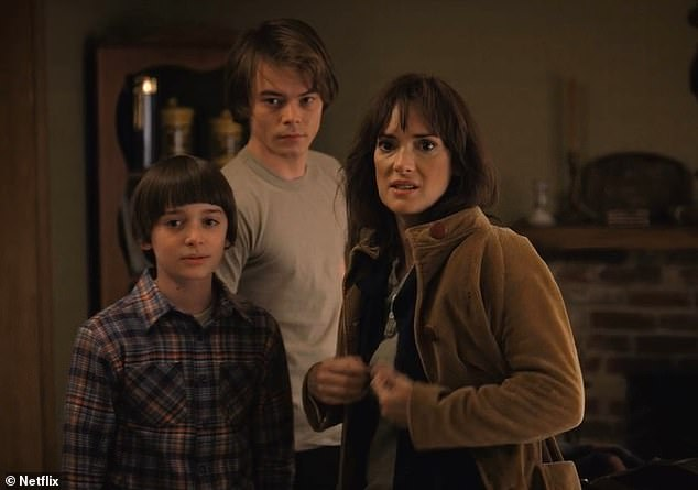 Advice: Stranger Things star Noah Schnapp, 14, has revealed that his on-screen mum Winona Ryder, 47, texts him advice (pictured with Charlie Heaton who plays Noah's on-screen brother)