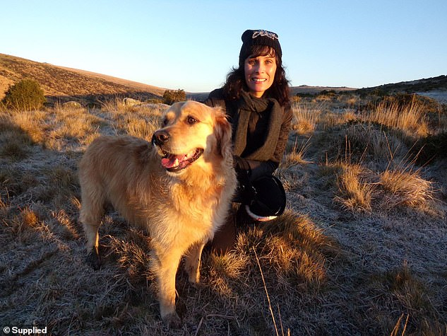 Sarah, pictured with her Golden Retriever Bear, said she managed to unlock herself after a Shaman said 'all the things I was too afraid to tell myself' in 30 minutes