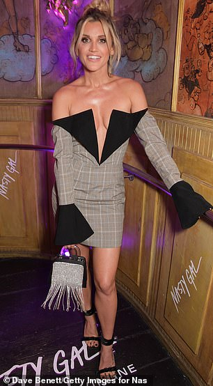 Striking: The outfit had dramatic flared sleeves and a low-cut lapel