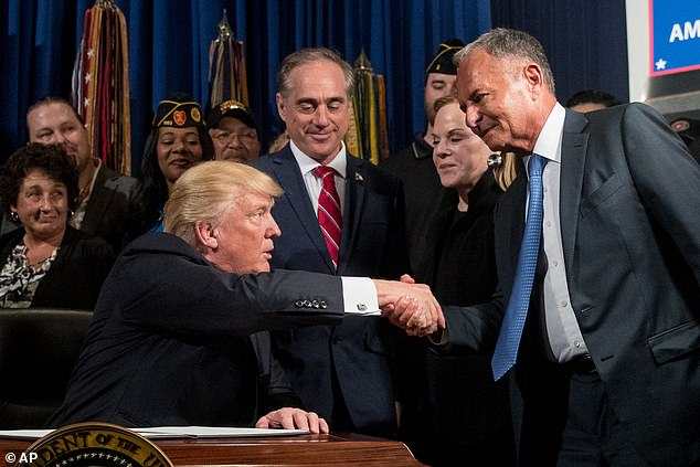 """President Donald Trump, left, accompanied by Veterans Affairs Secretary David Shulkin, center, shakes hands with Isaac """"Ike"""" Perlmutter, an Israeli-American billionaire, and the CEO of Marvel, right, before signing an Executive Order on """"Improving Accountability and Whistleblower Protection"""" at the Department of Veterans Affairs, Thursday, April 27, 2017"""