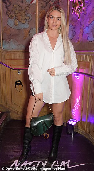 Legs for days! Louisa Johnson paired an oversized white shirt with black boots