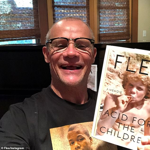 'Just got the first real finished copies!' Grand Central Publishing will release Flea's 400-page memoir Acid for the Children featuring a forward by Patti Smith on November 5 (pictured October 9)