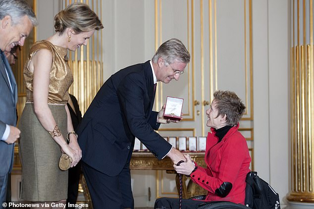 In the past she said it gave her the control and 'puts my own life in my hands'. Pictured:King Philippe and Queen Mathilde of Belgium with Vervoort in 2013during a ceremony for the new members of Nobility at Royal Palace, Brussels